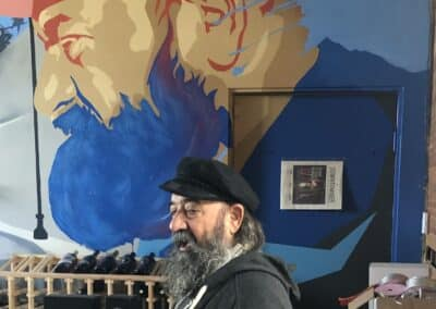 Le Chene's Juan Alonso with a Mural in his honor at Angeleno Wines